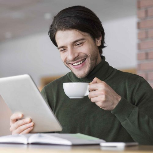 young-successful-businessman-checking-emails-while-4WJERT9.jpg